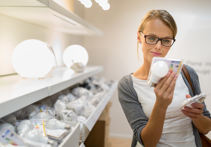 woman shopping for LED bulb